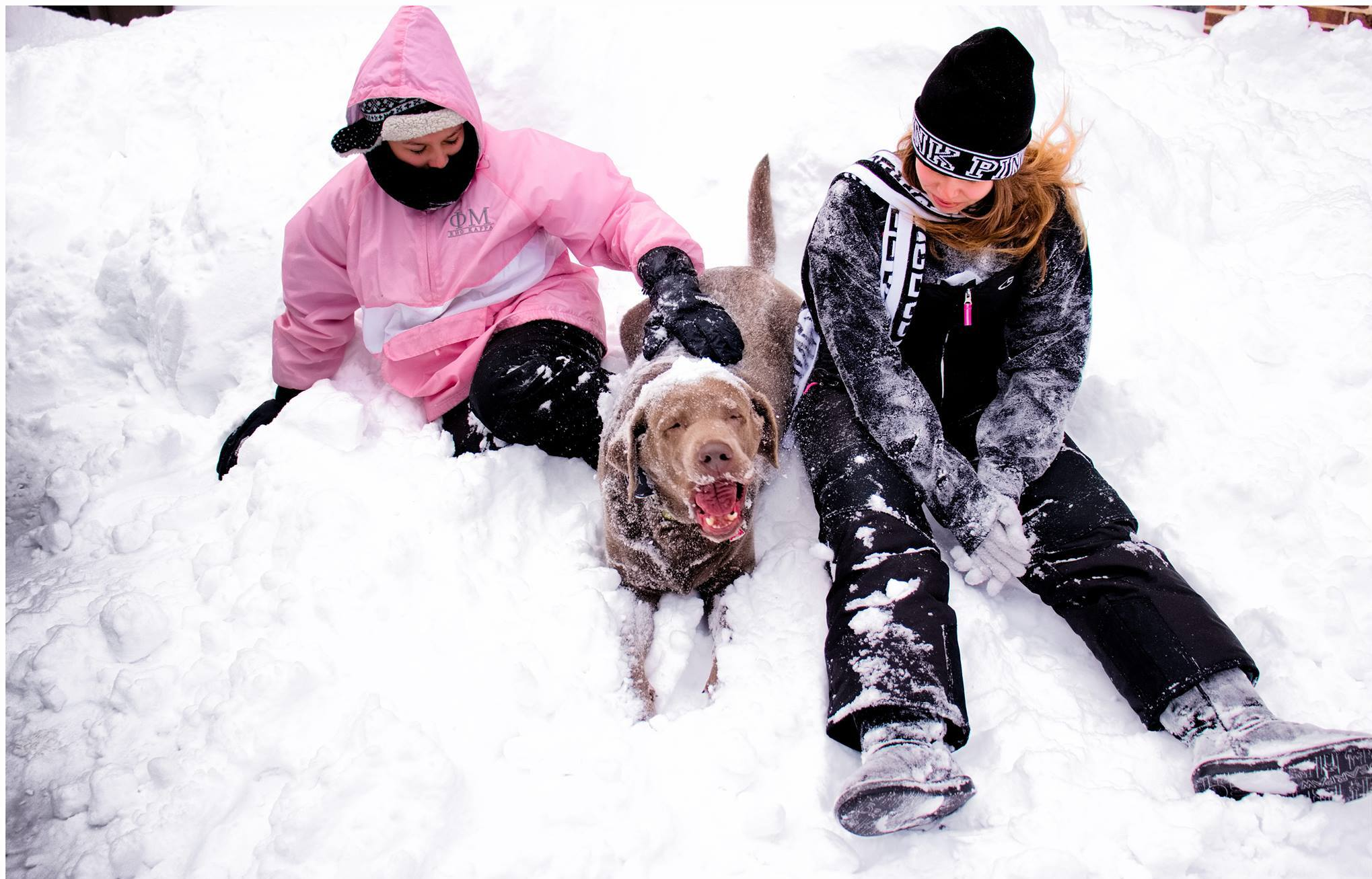 Kids and dog in snow