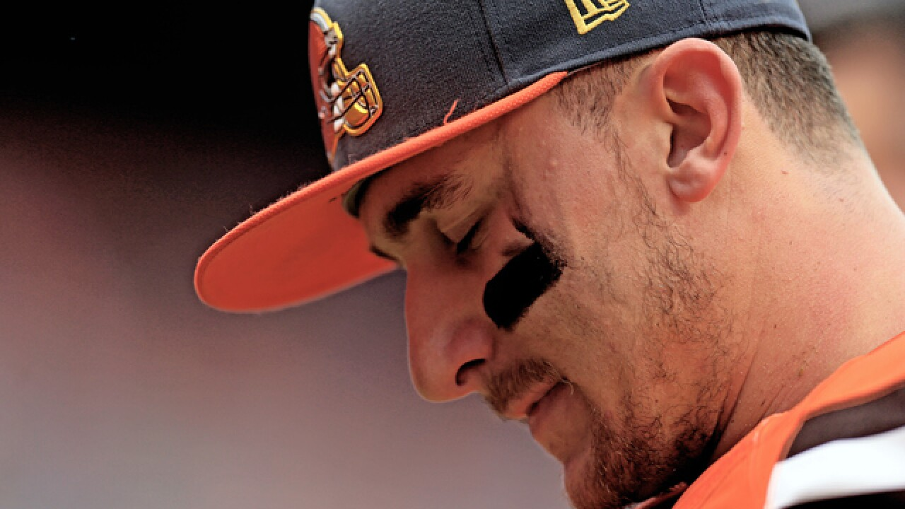 PD report claims Johnny Manziel hit girlfriend