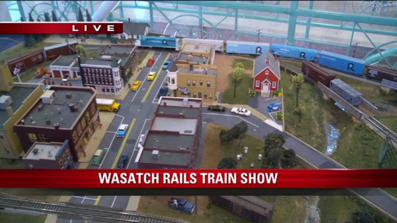 Big Budah rides a train at the Wasatch Rails Train Show