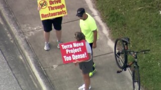 Protesters held a protest march at the Terra Nova site on Hagen Ranch Road and Atlantic Avenue in western Delray Beach on Feb. 25, 2020.