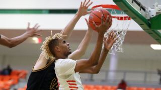 RATTLERS TAKE BITE OUT OF AGGIES