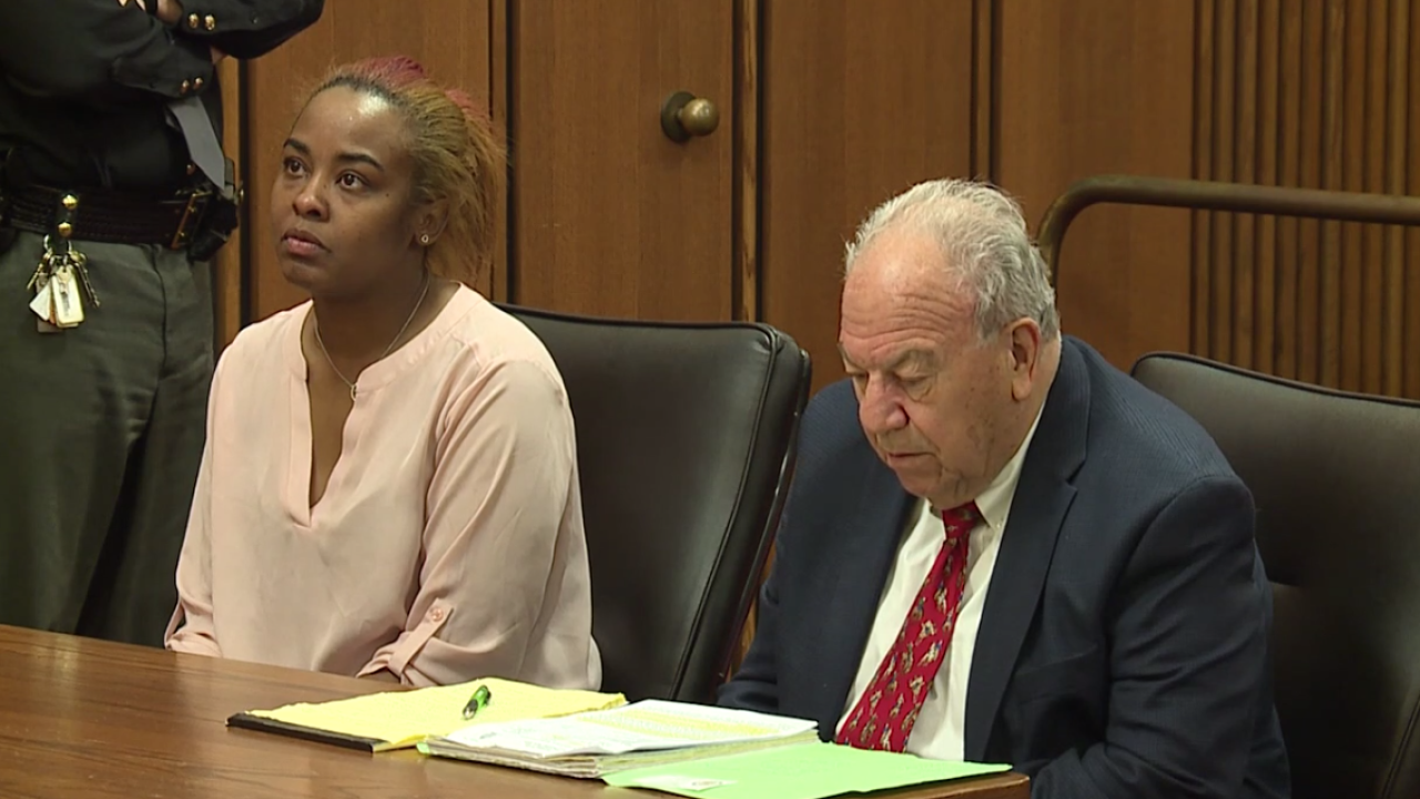 Christina Coleman in court for her sentencing with her lawyer.