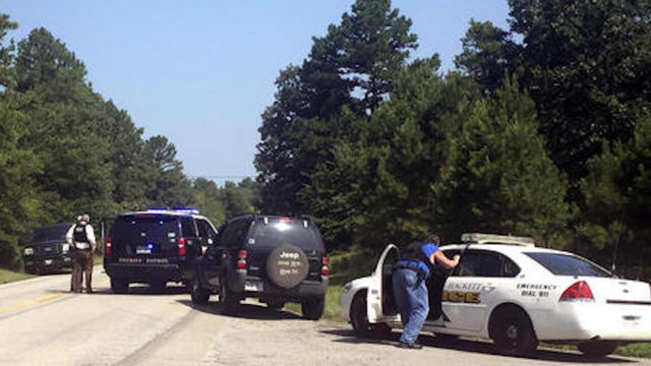 Two officers shot in rural Arkansas, one killed