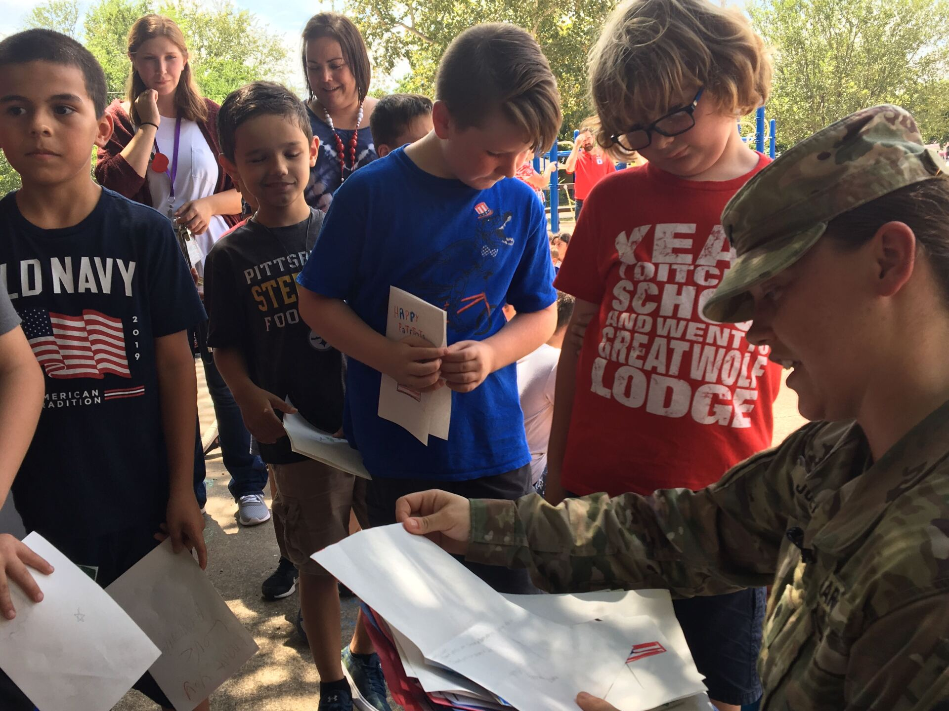 Leon Heights students make cards for First Responders, Military Adopters and present them to soldiers working their book fair on 9/11.