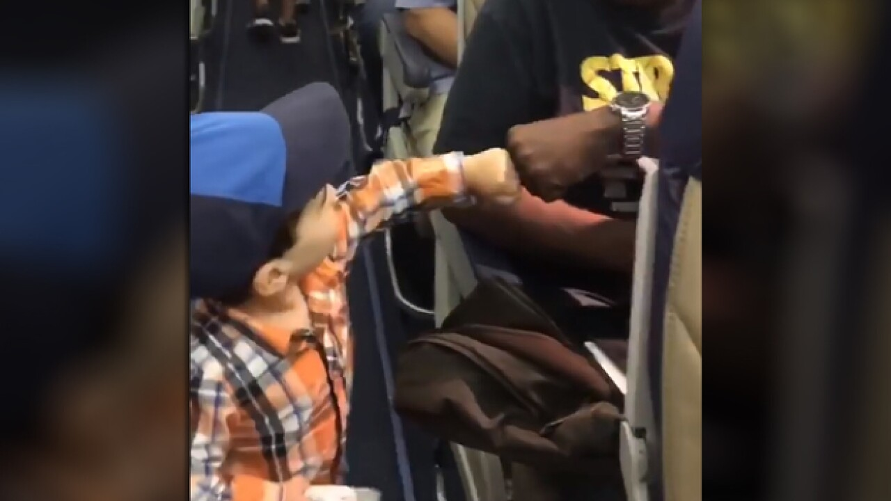 Two-year-old's greeting aboard flight goes viral