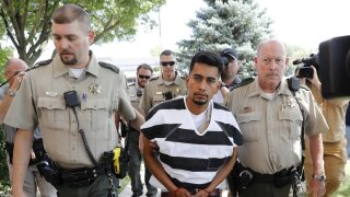 FILE - In this Aug. 22, 2018, file photo, Cristhian Bahena Rivera is escorted into the Poweshiek County Courthouse for his initial court appearance in Montezuma, Iowa. Lawyers for Rivera who is charged with killing Tibbetts are asking a judge to throw out evidence discovered during a faulty interrogation, including the victim's body. A court hearing is scheduled Wednesday, Nov. 13, 2019, to consider the matter. (AP Photo/Charlie Neibergall, File)