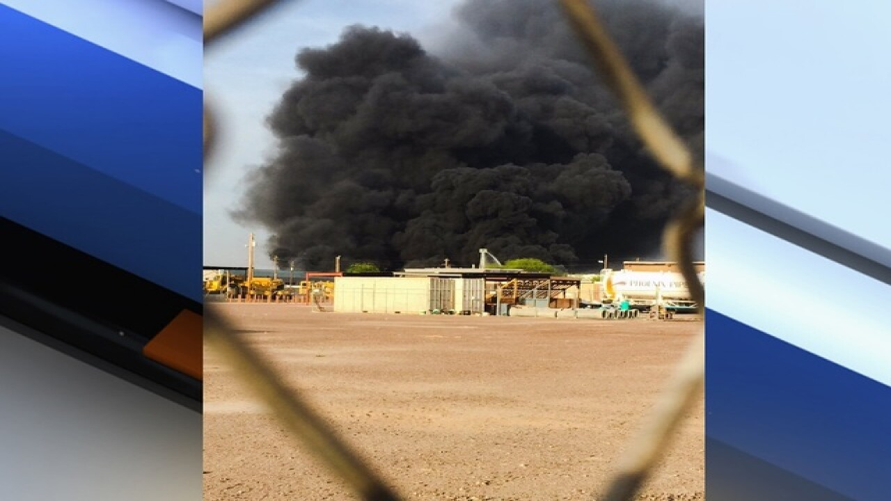 PHOTOS: Fire burns at PHX recycling plant