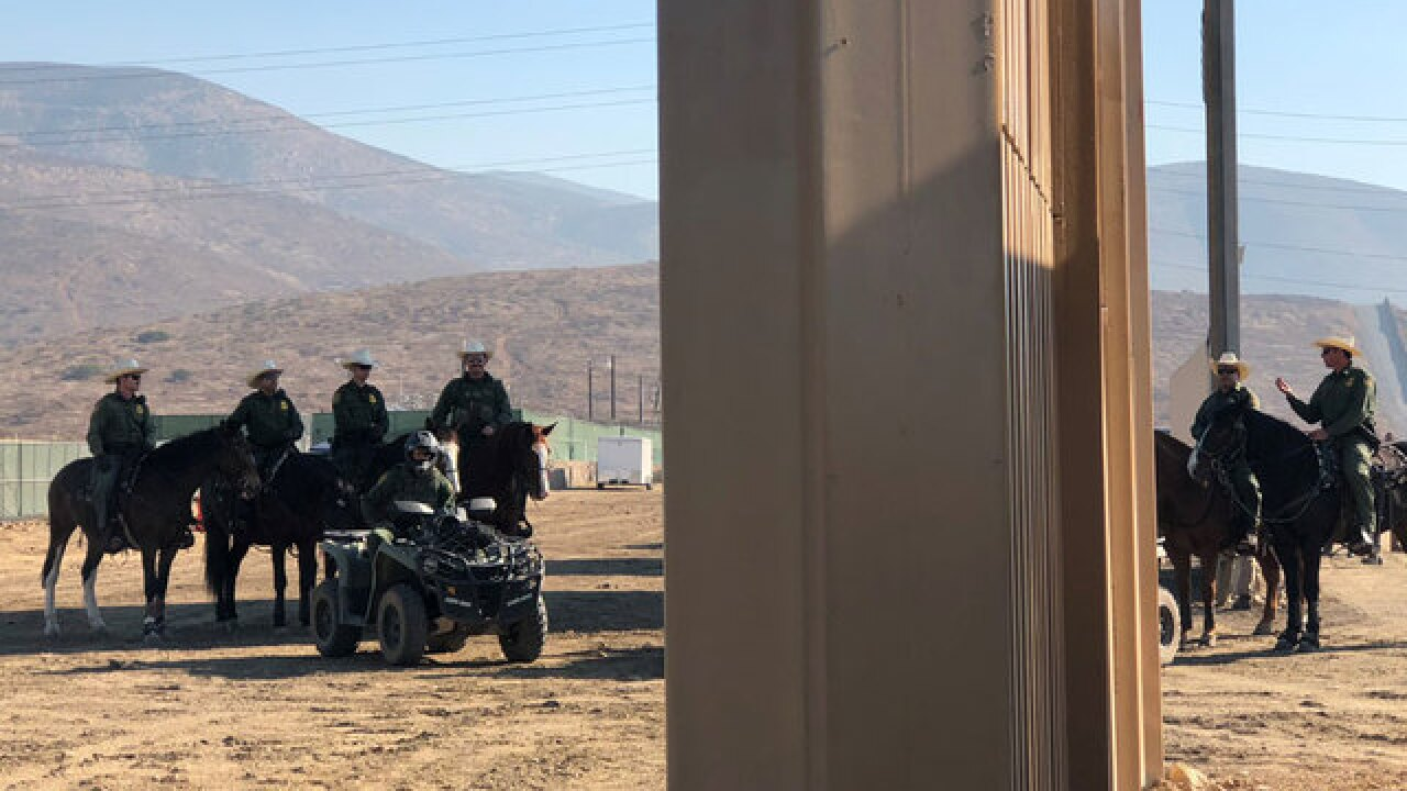 Feds inspect border wall prototypes in SD