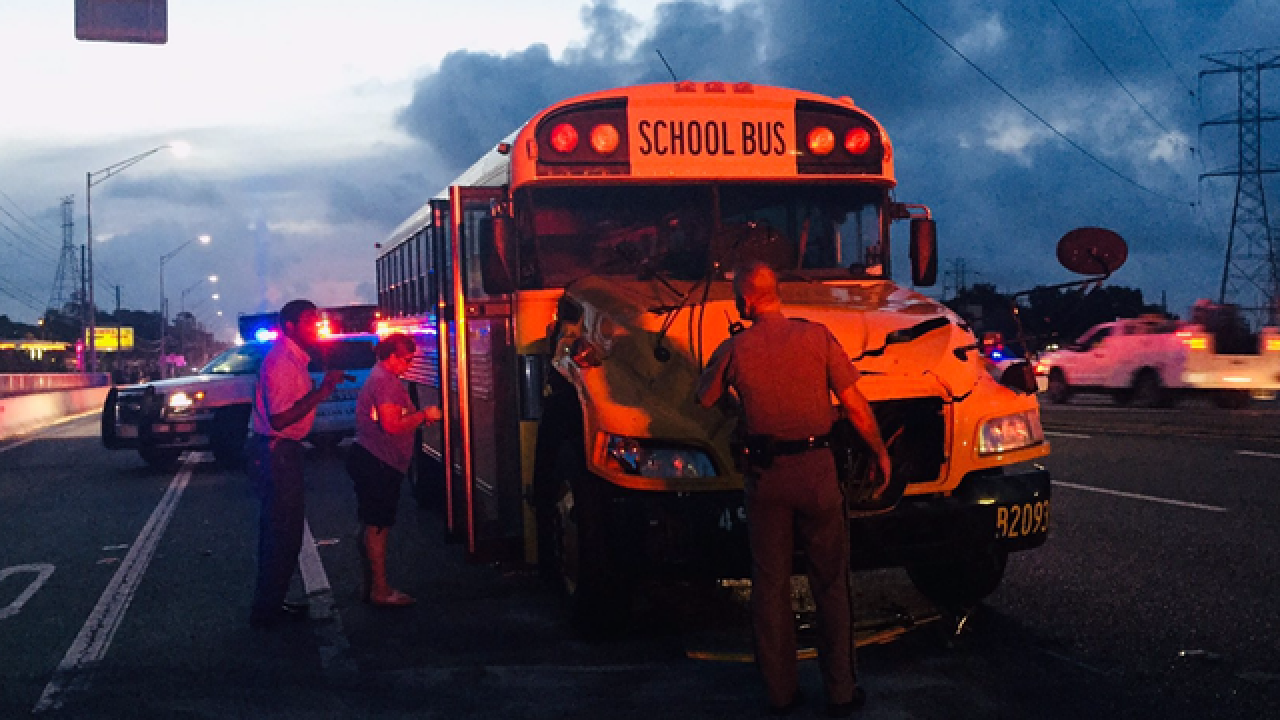 4 high school students transported to hospital after school bus crashes into semi in Pinellas County