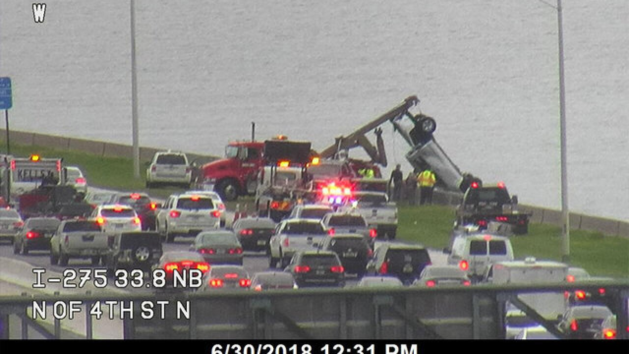 Vehicle pulled from water after it went over guardrail on Howard Frankland Bridge