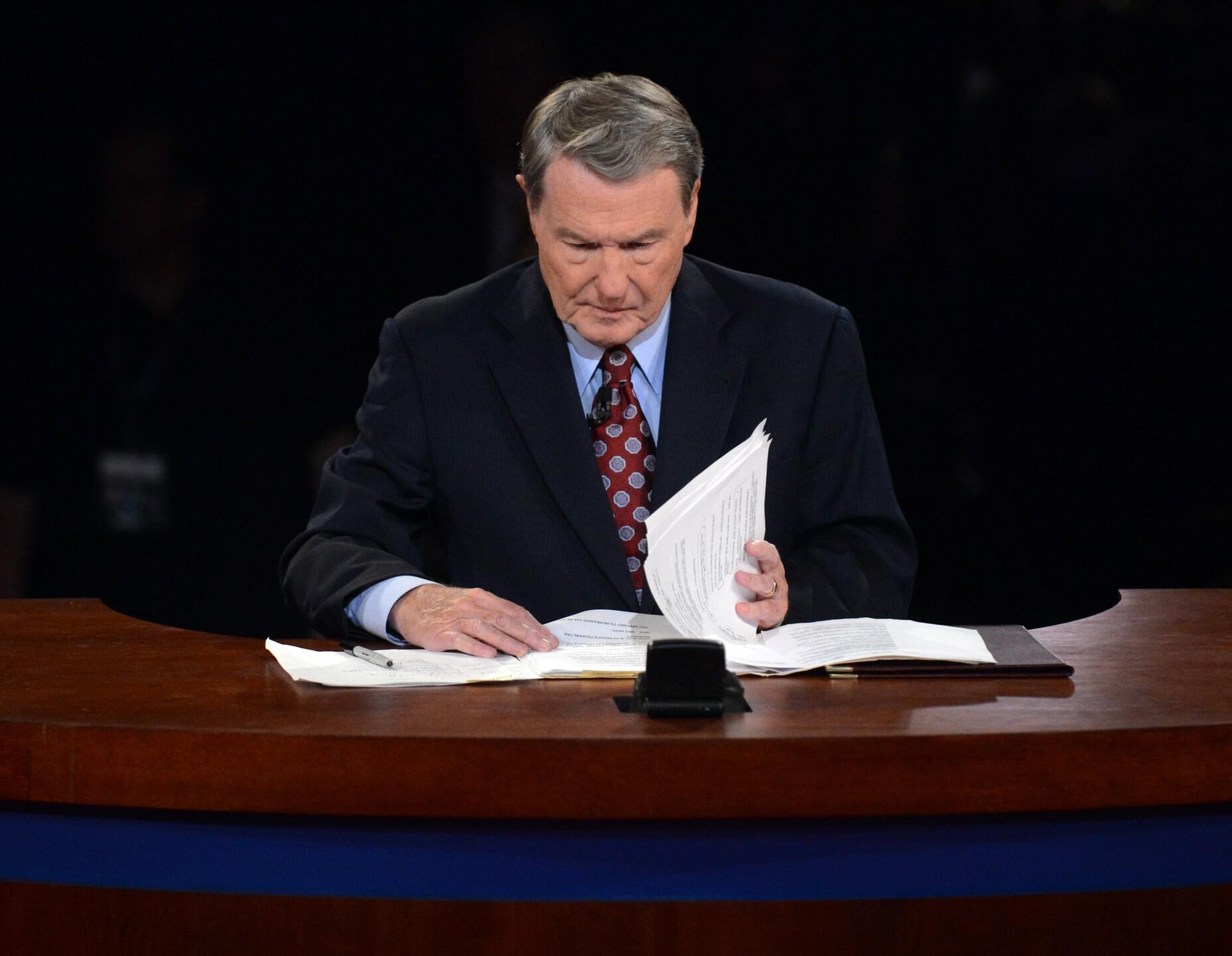 Photos: Longtime PBS NewsHour anchor Jim Lehrer dies at85