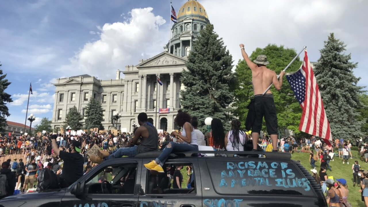 Thousands converge on the State Capitol in Denver for a fifth night of protests