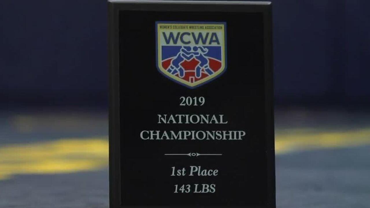 National Championship plaque of Lakeland University female wrestler