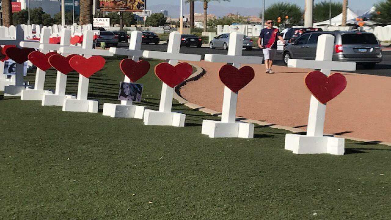 White crosses honor victims at Las Vegas sign