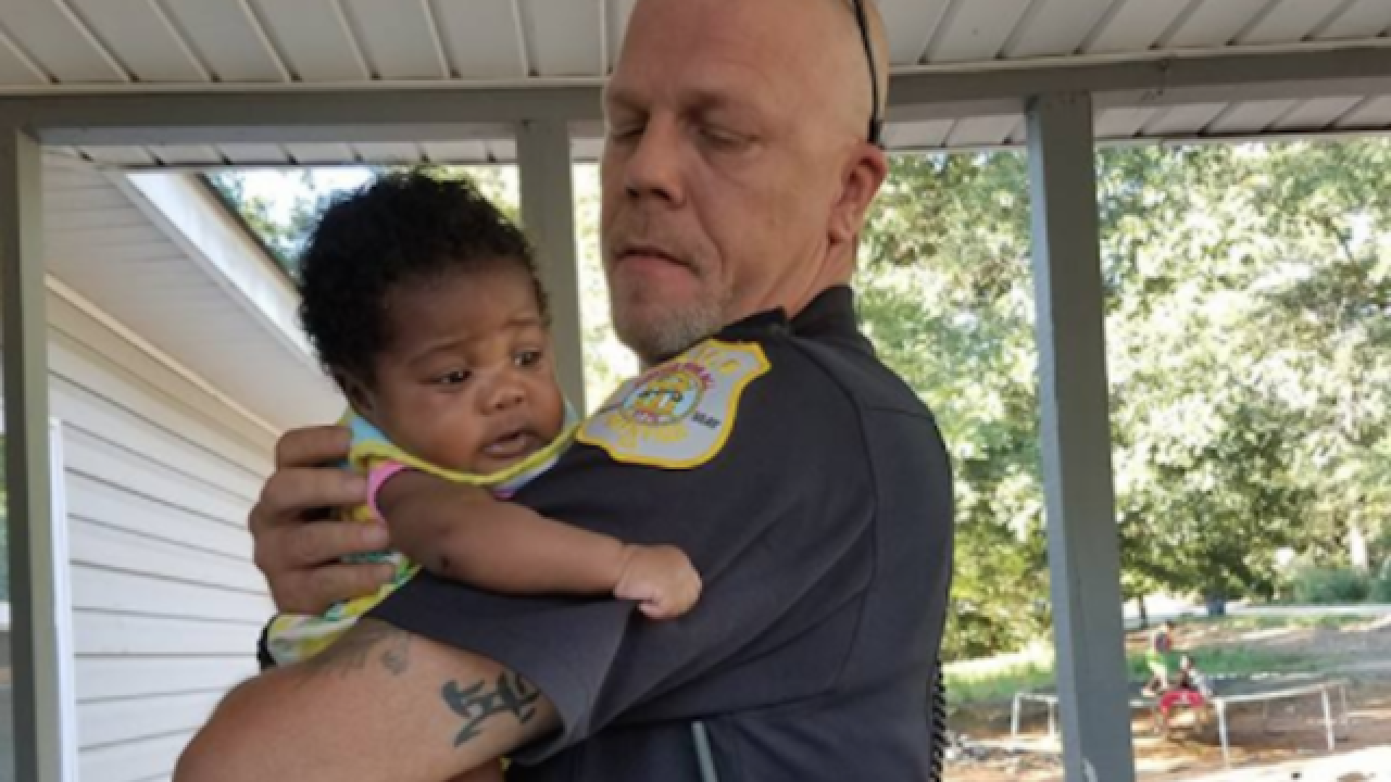 Georgia cop saves girl from choking, agrees to become her godfather
