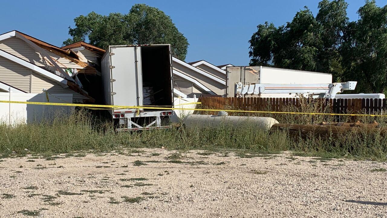 Semitrailer 'blasts' through intersection, storage buildings in GardenCity