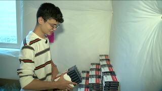 erie teen delivering free covid testing kits.jpg