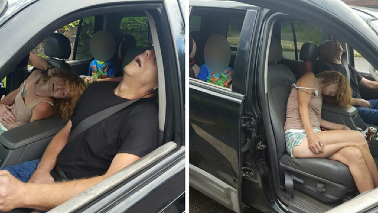 Police take shocking photos of two adults overdosing in car with child in back seat