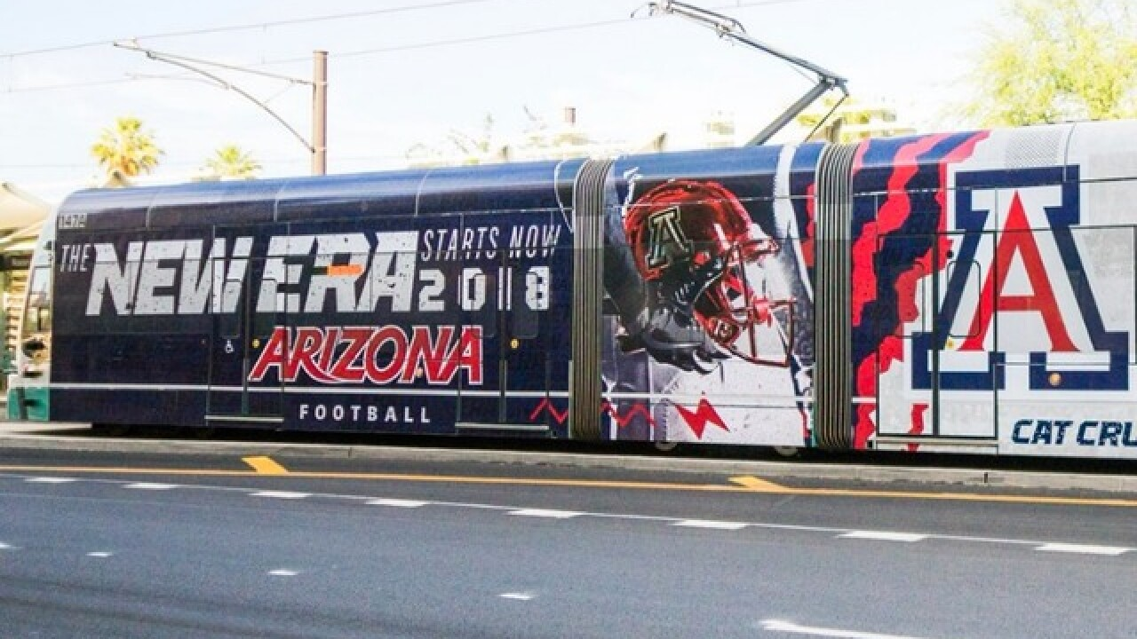 Arizona Wildcats take over Valley light rail train with giant football ad