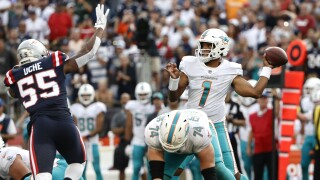 Miami Dolphins QB Tua Tagovailoa passes at New England Patriots in 2021