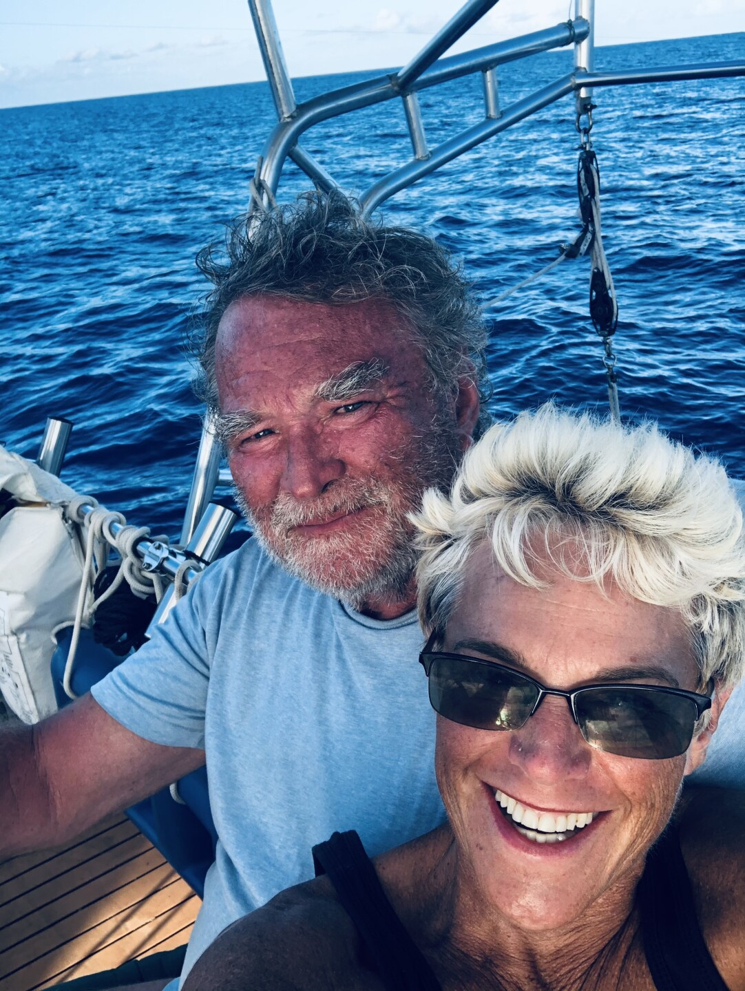 Marty Widrick and Sven Karrlson smiling at sea