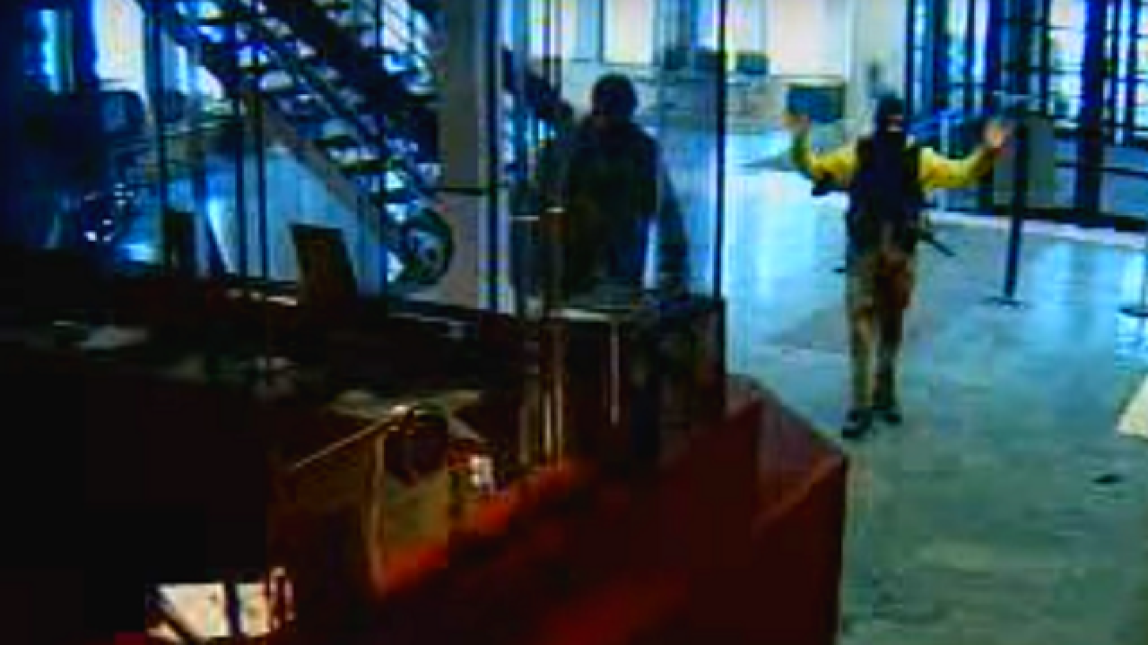 Video: Men walk in Dearborn PD armed with AR-15