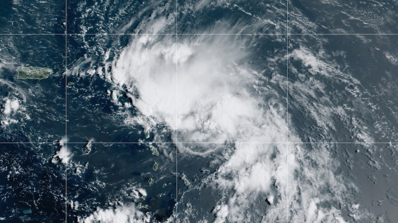 Laura nears hurricane status as it gains strength in the Gulf of Mexico