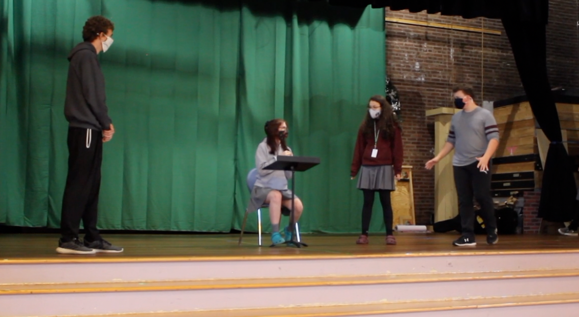 Students have to wear masks and social distance on stage