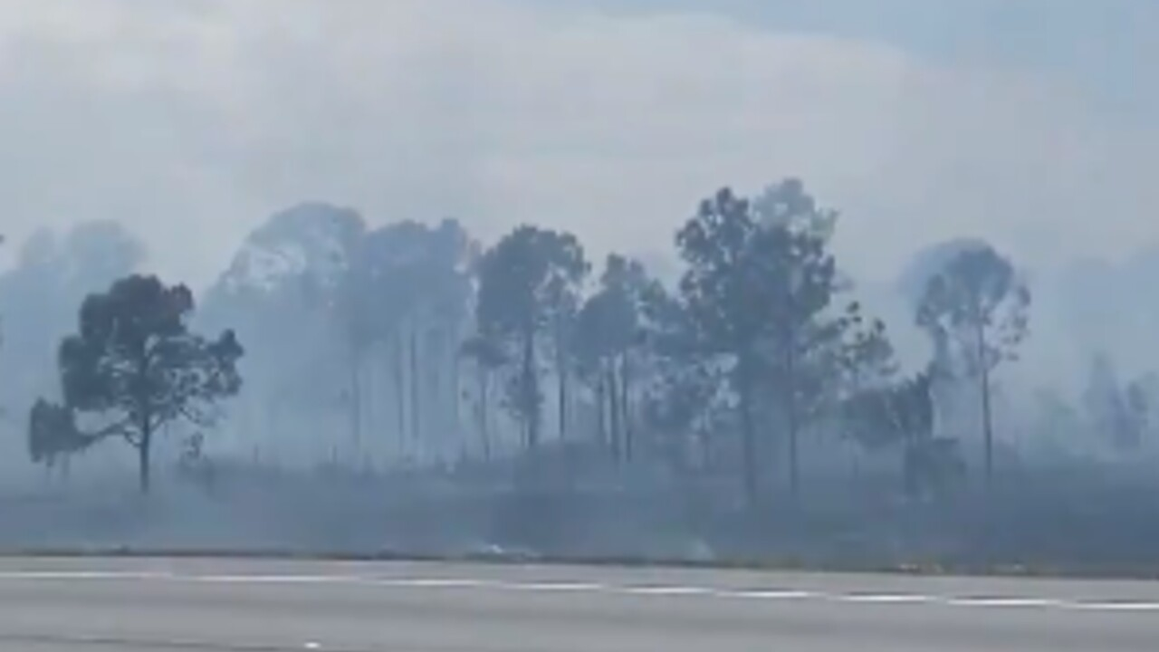 A brush fire shuts down all lanes of Florida's Turnpike in Palm City on March 19, 2021.jpg