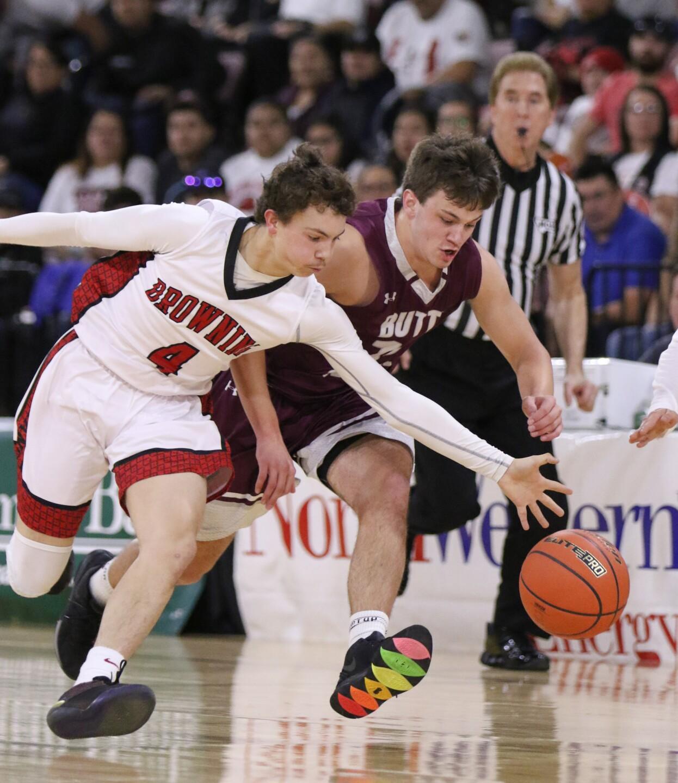 Cody Carlson and Trevor Neumann reach for the ball.jpg