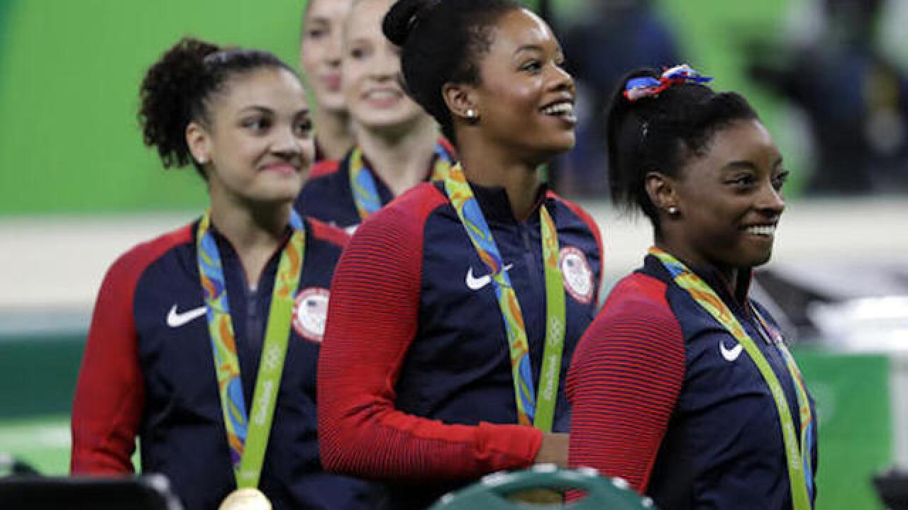 Simone Biles, Gabby Douglas mixed by newspaper