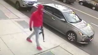 Man with assault rifle on Bronx street
