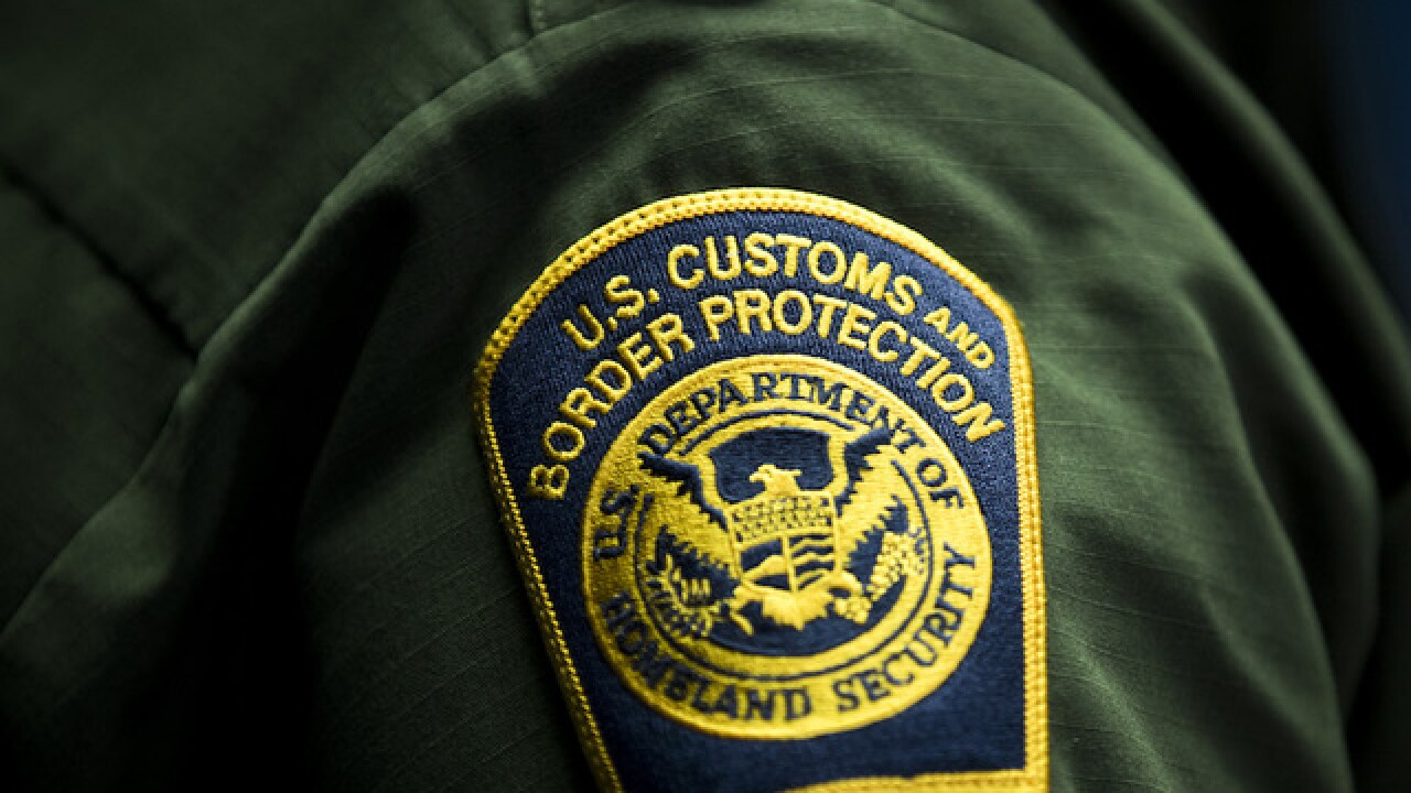 US border officer falsely claimed to be US citizen, authorities claim