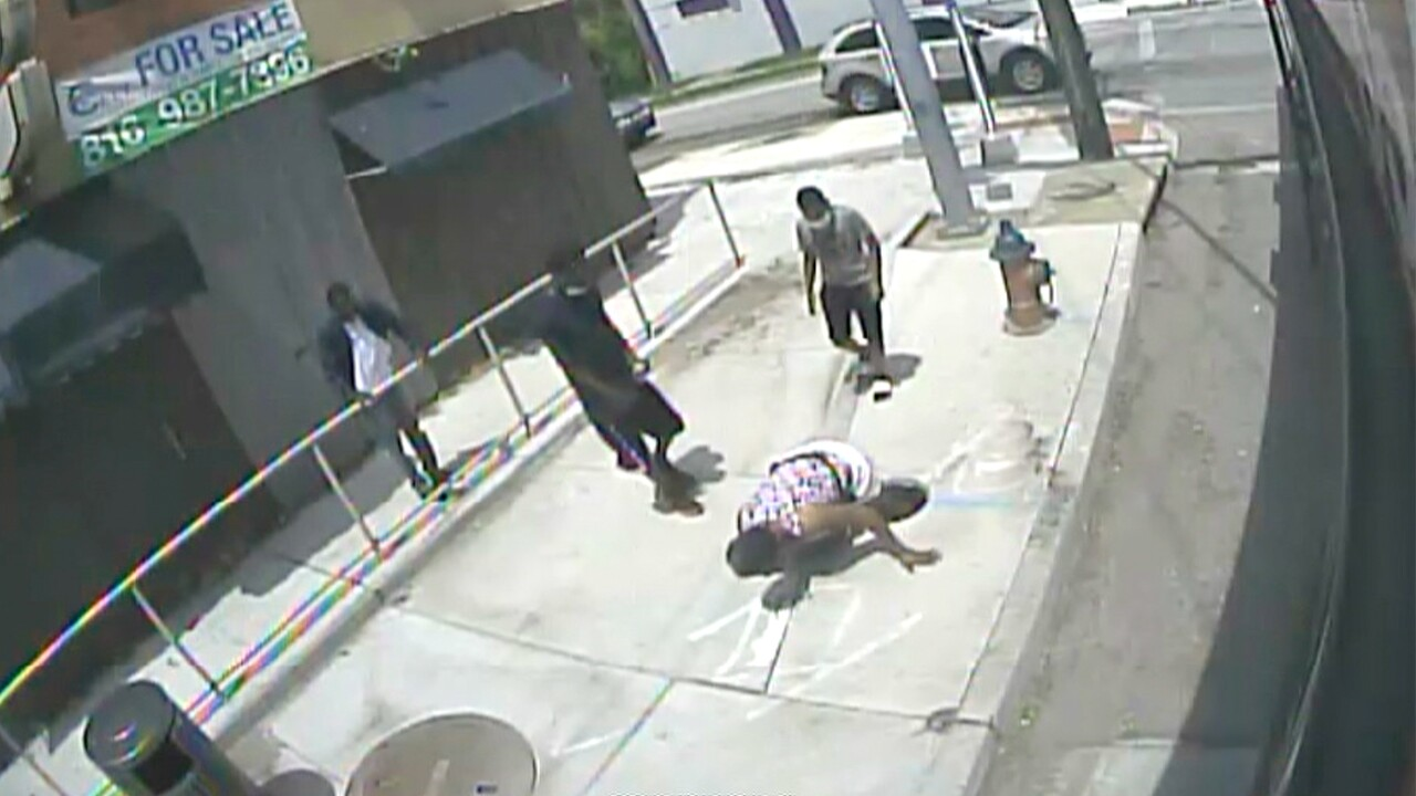woman falls into open manhole.jpg