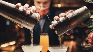 A bartender at 1000 North in Jupiter pours holiday cocktails.