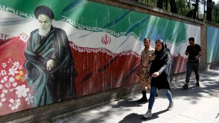 Iran exceeds uranium caps set by nuclear deal, foreign minister says