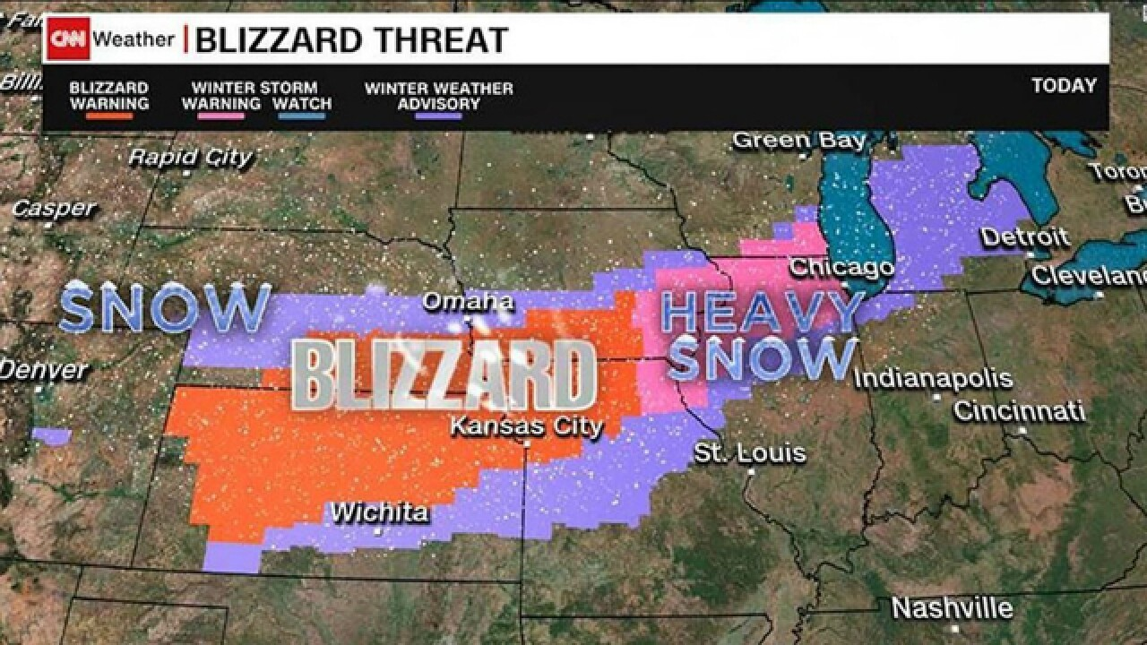 Hundreds of flights canceled as blizzard conditions move across Midwest