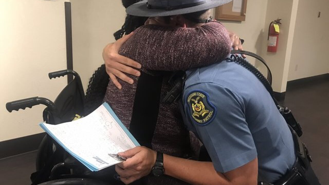 KC woman reunited with trooper who rescued her
