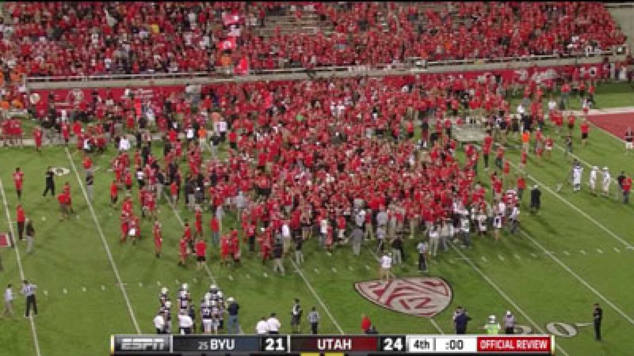 Utah barely holds off BYU, own fans in 24-21 win
