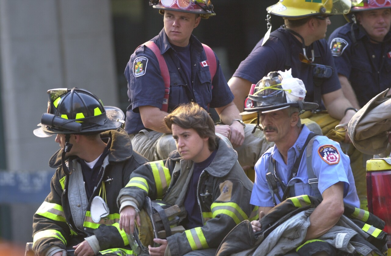 firefighters rest near ground zero after New York City terrorist attacks, Sept. 13, 2001