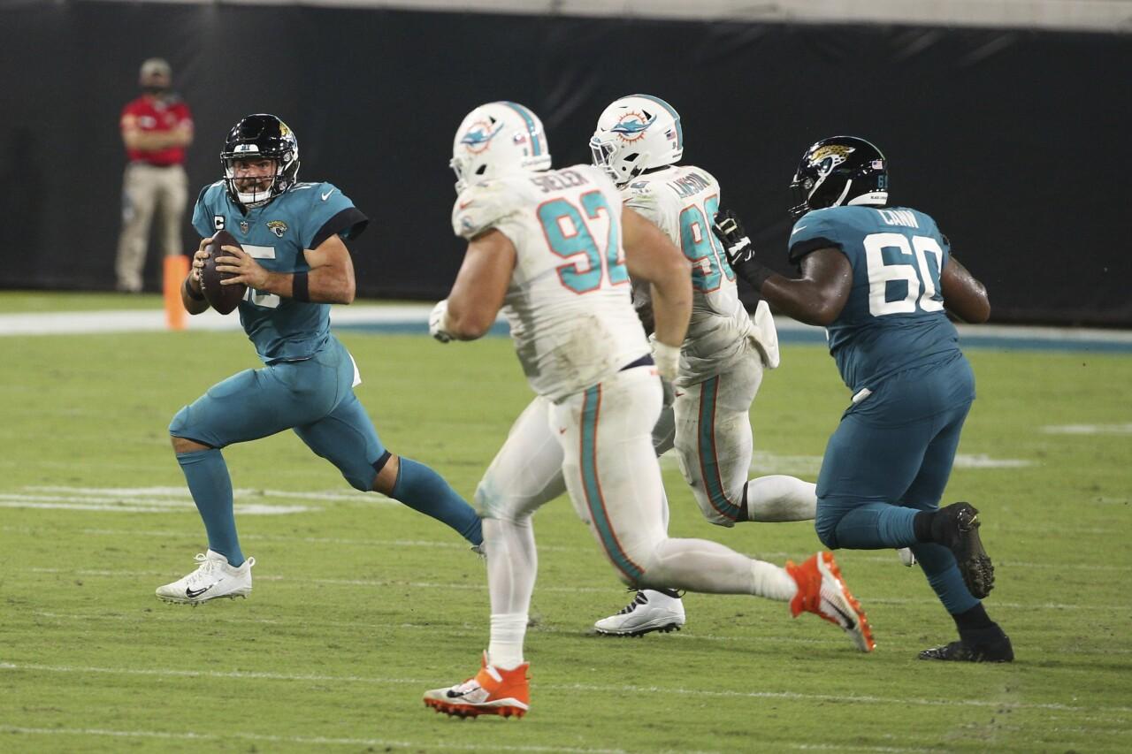 Miami Dolphins defensive tackle Zach Sieler chases Jacksonville Jaguars QB Gardner Minshew in 2020