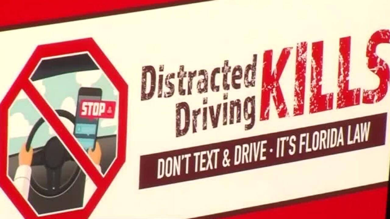 wptv-texting-while-driving-kills-sign.jpg