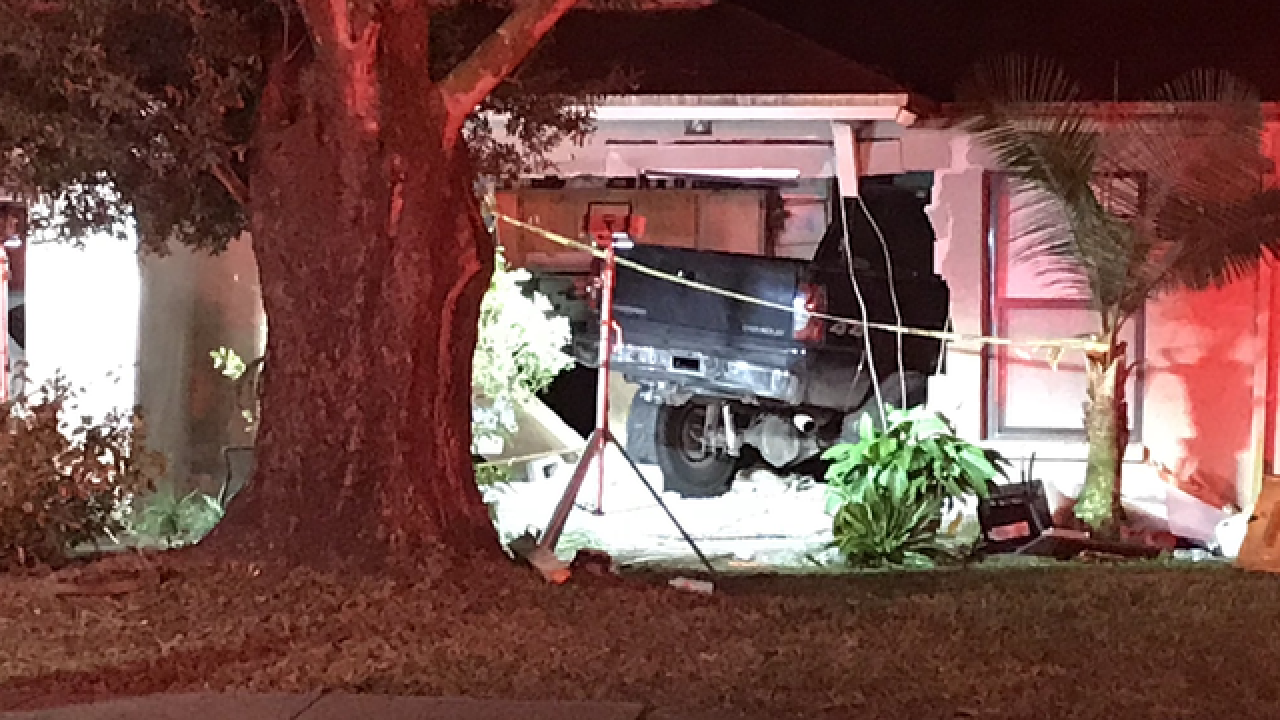 Truck plows into home, pins 71-year-old under it