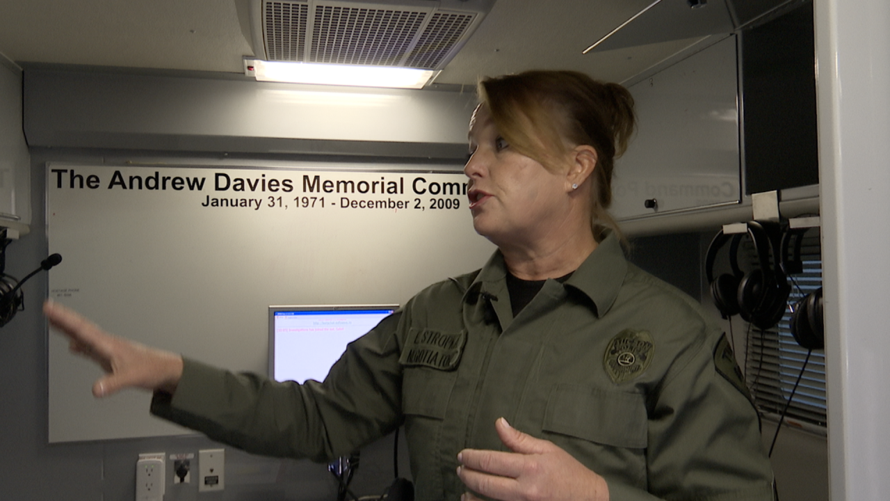 """Sgt. Ericka Stropka stands inside the Hostage Negotiations Team's command post, called """"The Knock"""""""