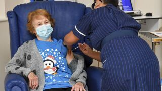 90-year-old woman in England is the first to receive initial dose of Pfizer's COVID-19 vaccine
