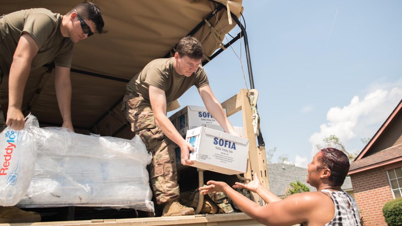 Oklahoma National Guardsmen distribute food, water to Louisiana neighborhoods after Hurricane Ida