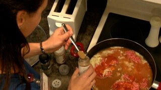 woman cooking for at-home hospice patients
