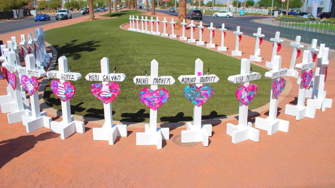 Man sets up crosses at Las Vegas' welcome sign