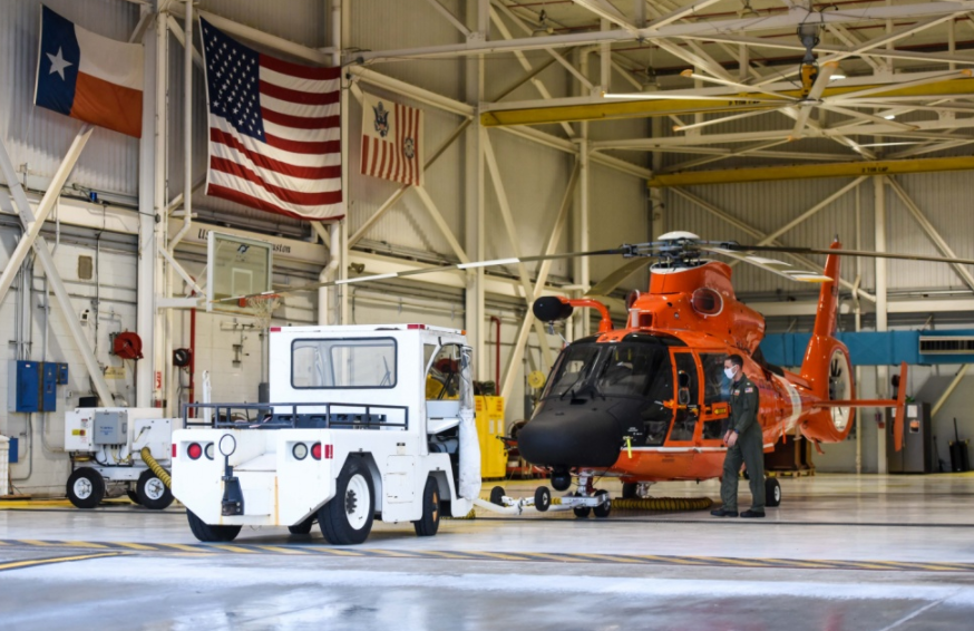 Lt. Jordan Kellam, a Coast Guard Air Station Houston helicopter pilot, conducts a pre-flight check of an MH-65 Dolphin helicopter to ensure the aircraft is safe for flight Aug. 22, 2020. Crews at Air Station Houston are standing by to assist those affected by tropical storms Marco and Laura along the Gulf Coast. (U.S. Coast Guard photo by Petty Officer 1st Class Kelly Parker)