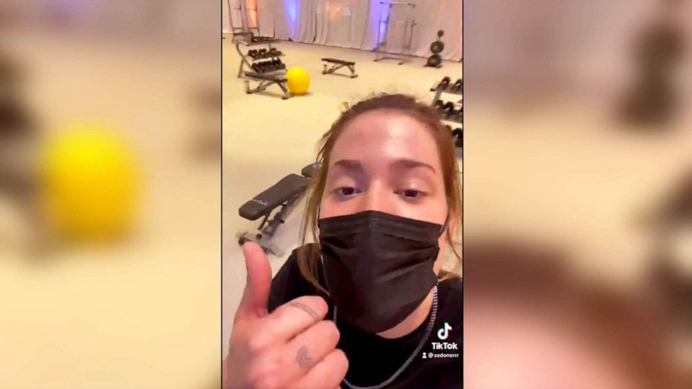 A Tik Tok video posted by Sedona Prince shows Price standing in the upgraded women's weight room at March Madness in San Antonio after improvements were made in response to her prior social media post.